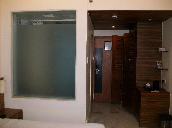 Hotel Jewel Of Chembur : Door and Bath+Toilet on the left behind the frosted glass