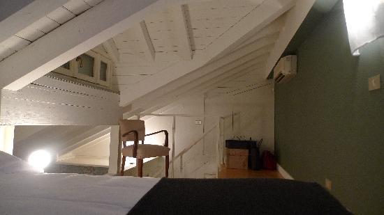 Brera Apartments: i love this attic bedroom
