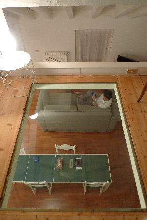 Brera Apartments: glass floor from the attic