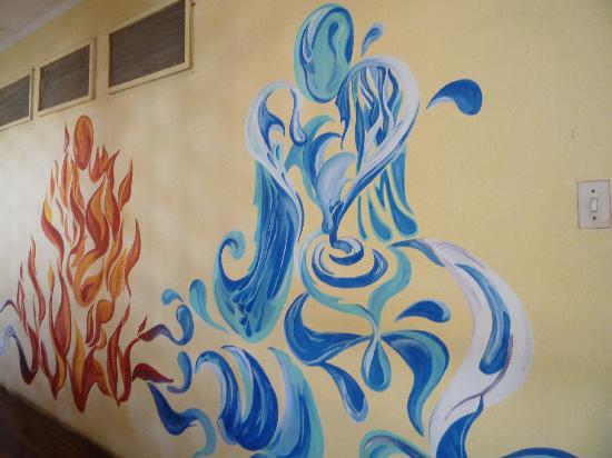Hostel Pachamama: Beautiful art decorate the walls of the common areas