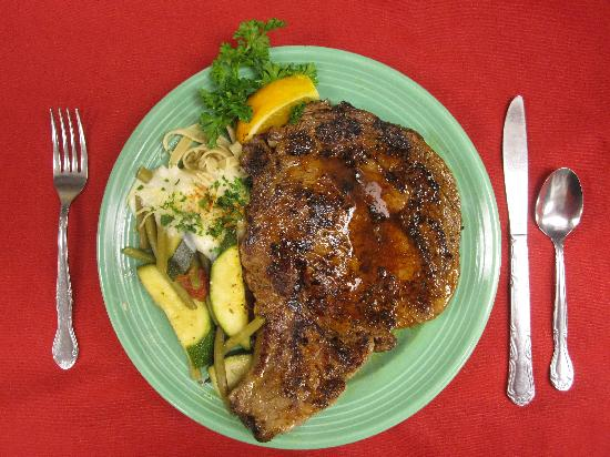 Evan's Old Town Grille: Our 18oz. Prime Rib, roasted to perfection (and in this case, blackened too!)