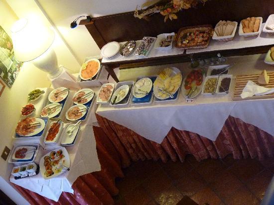Hotel le Volpaie: Coin déjeuner