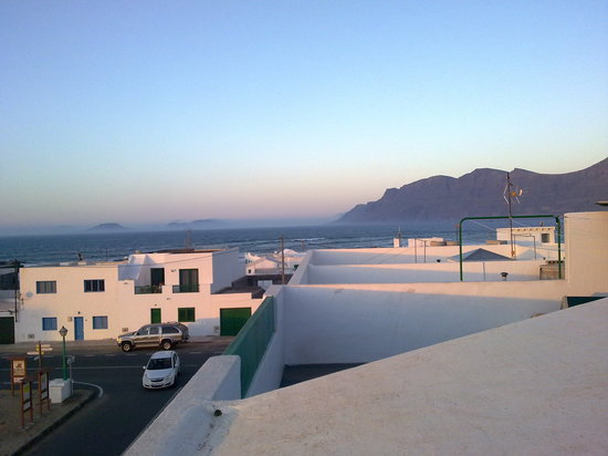 Surf School Lanzarote: Rooftop Dinner view: Tired arms and a big smile!