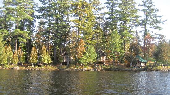 Gorman Chairback Lodge and Cabins: View of several of the cabins from a canoe on the water