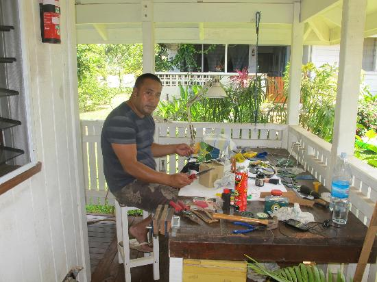 Neiafu, Tonga: Tai working on his glasses