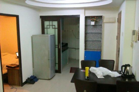 Siyecao Jinsheng Apartment Hotel: vers la cuisine