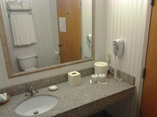 Clarion Hotel Airport: The Bathroom (The Actual Water Glasses are a Nice Touch)