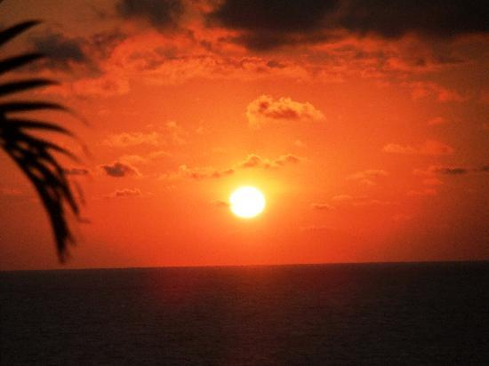 Marival Residences Luxury Resort: One of the many beautiful sunsets from our balcony