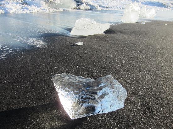 Iceland Aurora Photo Tours - Day Tours: Ice on a black sand beach at Jökulsárlón