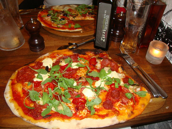 Zizzi -  Glasgow West End: Rustica Piccante in front and Calzon'Pizza Contadina in the back