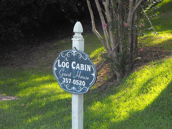 Log Cabin Guest House: sign