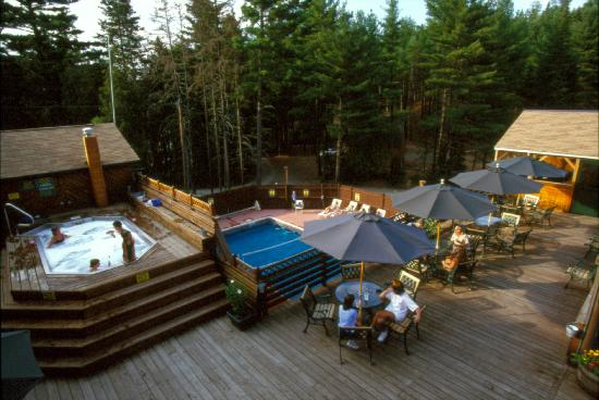 Enjoy dinner on the back deck patio overlooking the pool and giant hot tub