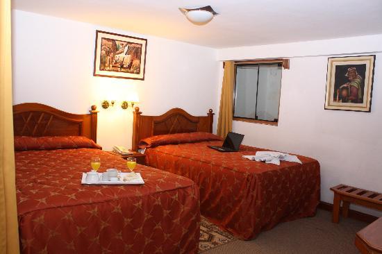 Amerinka Boutique Hotel: habitacion boble que le brindara un confort en su descanso