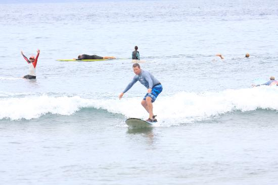 Royal Hawaiian Surf Academy: Me on my first wave with Kea in the background with arms raised!