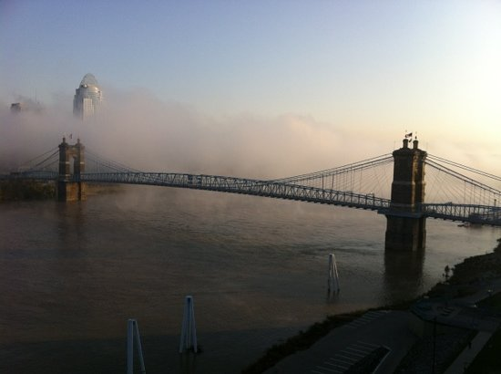 Cincinnati, OH: Early morning fog rolling down the Ohio under the bridge.