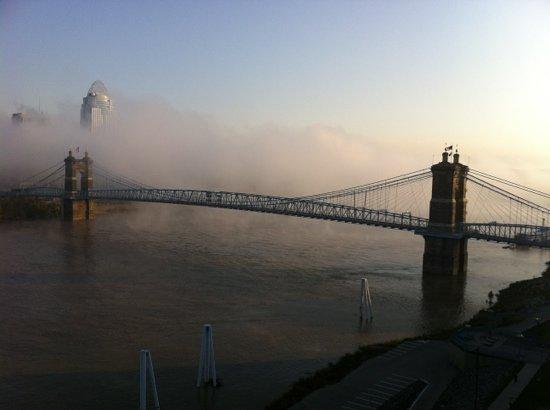 Roebling Suspension Bridge: Early morning fog rolling down the Ohio under the bridge.