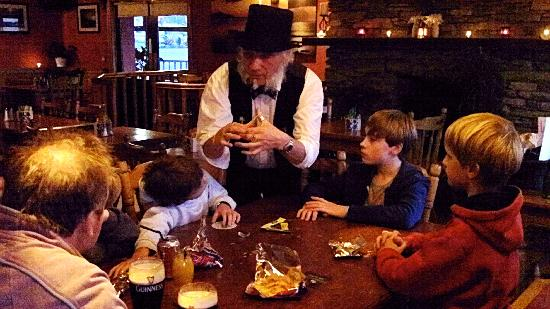 Tralee Bay Holiday Village: The magician at work...on the next table..