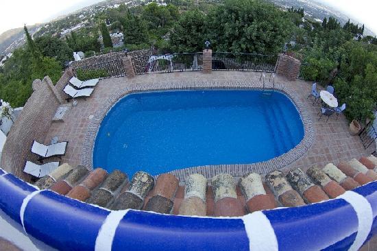 Casa Caleta: piscina dalla terrazza