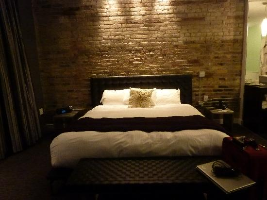 Hotel Metro: King bed w/ leather headboard.
