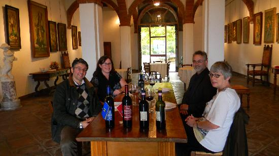 Tours in Tuscany - Private Tours: Marco joining us for a picture in the wine tasting room at the vineyard