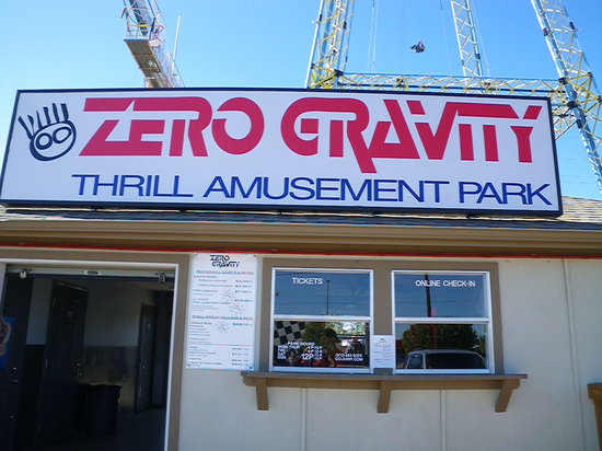 Zero Gravity Thrill Amusement Park: look at the guy falling on top of the building!