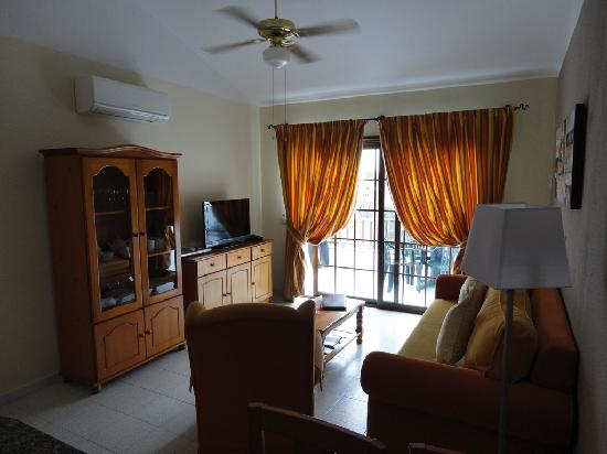 Sunset View Club by Diamond Resorts: Hall with sofa and balcony