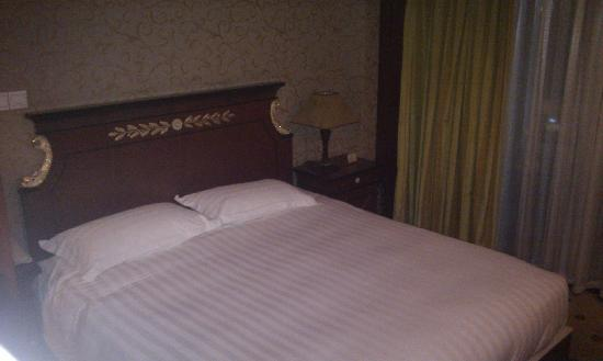 Salvo Hotel Shanghai: Zona letto