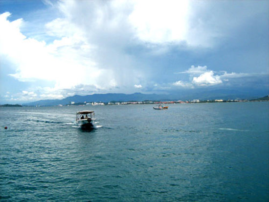Mamutik Island: Looking back to KK, with a ferry approaching the jetty