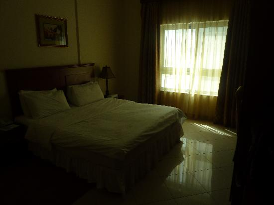 Legacy Hotel Apartments: chambre