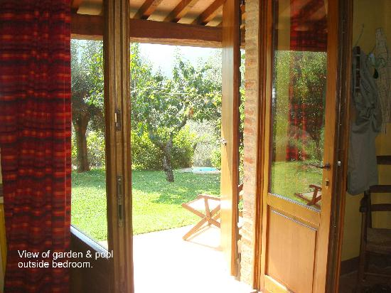 Il Fontanaro: View of garden & infinity pool outside the bedroom's French doors