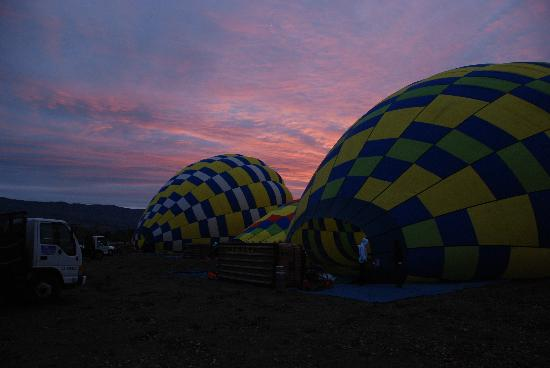Balloons Above the Valley: Inflating the balloons at sunrise