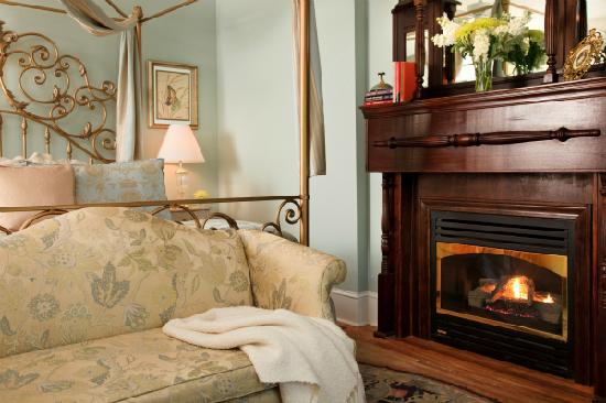 The White Doe Inn: All guest rooms have a working fireplace to enjoy. Here in the Garden Room you can enjoy the fir