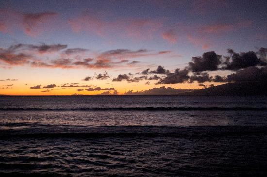 Hale Kai Oceanfront Condominiums: The view from the lanai of Molokai at sunset.