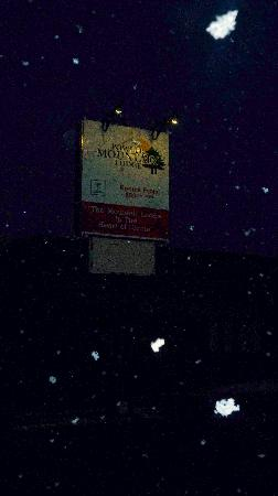 The Powder Mountain Lodge sign on a very snowy night