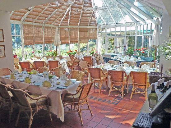 Redcoats Farmhouse Restaurant: Our conservatory is an informal and intimate place to dine