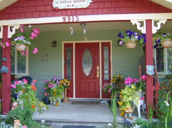 A Scented Garden Bed and Breakfast: Relax on the flower-filled porch