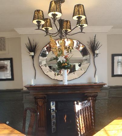 The Cross Scythes Totley: cosy fireside in restaurant