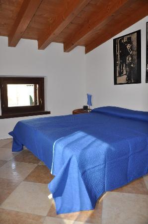 La Casa di Pierina: Stanza da letto dell'appartamento Blu