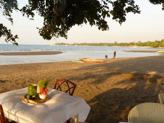 Sunset from beachfront Lilin Lovina Beach Hotel
