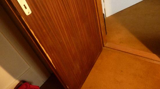 Hotel Dora: battered door / sticky carpeting