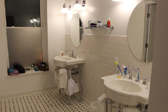 The Gould Hotel: Double pedestal sinks in large bath