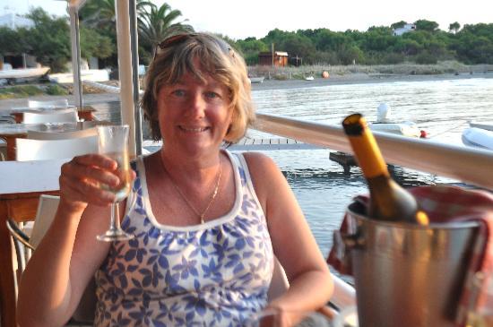 Restaurant Tamarindos: Enjoying a glass of cava at Tamarindos' outdoor seating area, overlooking the bay.