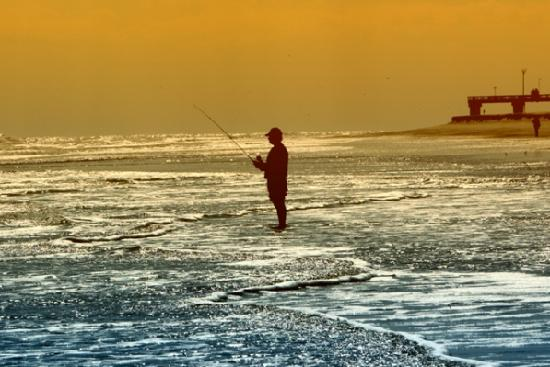 Crescent Beach, FL: Fisherman at Sunset