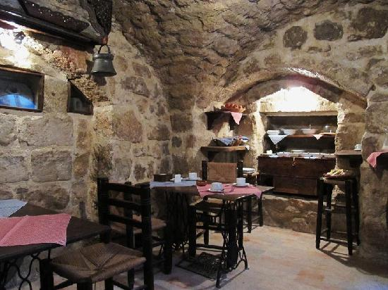 Hanania Hotel's cellar breakfast room with small buffet