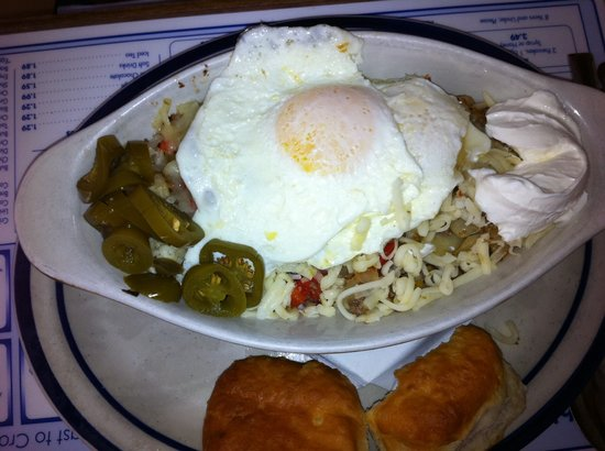 Peter's Pancakes & Waffles: #5, Huevos Enrrique.  Tricolored Sweet peppers, onioins and sausage over diced potatoes.  Add 2