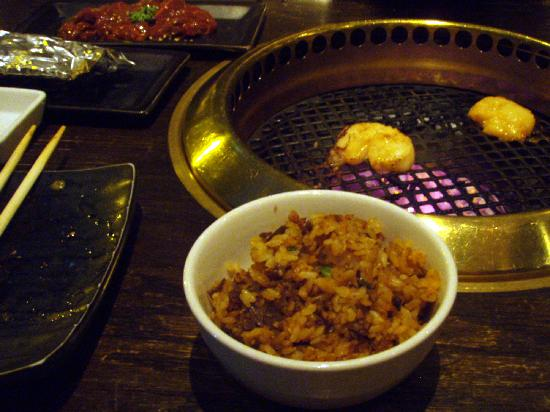 Gyu-Kaku - Mid Town : Rice, cooked at the table in a hot, iron bowl, spiced to taste