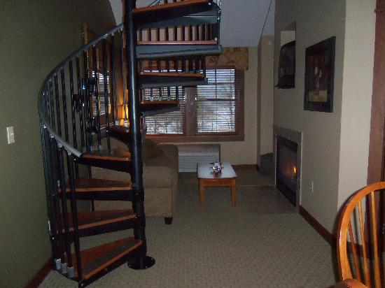 Suites at Silver Tree: Living area with spiral staircase to the loft bedroom.