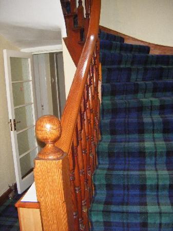 Glenardran House: Entryway and the lovely tartan carpet!