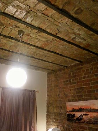 Violet Suite: room with exposed brick