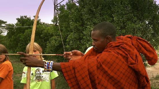 Mara Eden Safari Camp: masai warrior showing guests a how to hunt